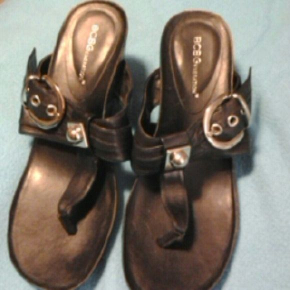 BCBG SANDLES Beautiful black platform leather sandles.  They are accented with silver buckle and accent.  Worn once to a wedding.  Had lots of compliments.  Excellent shoe BCBG Shoes Wedges