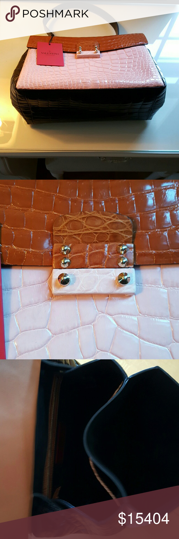 Tricolor Valentino satchel. With silver hardware. Black,brown and light pink crocodile skin satchel purse. One zip pocket inside along with two open pockets.I purchased at Neiman Marcus. The original price was $25,675.00. I paid $15,404.99 and ive never used it. The original Valentino tag is inside and the Neiman Marcus tag is still attached on the strap. I am willing to negotiate the price as long as you keep it reasonable and respectful.This is in beautiful condition! No trades…