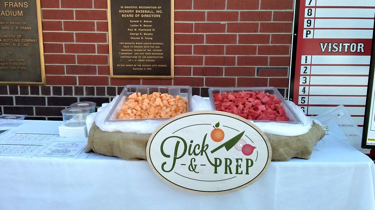 Pick & Prep cantaloupe and watermelon table at Crawdads