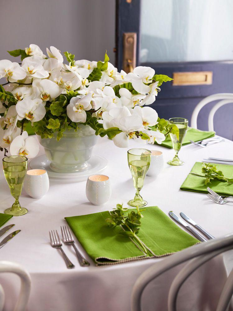 white orchids + green napkins/glasses