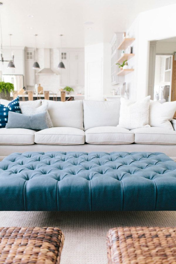 Tour A Home That Checks All Our Favorite Design Trend Boxes Ottoman In Living Room Living Room Furniture Blue Ottoman