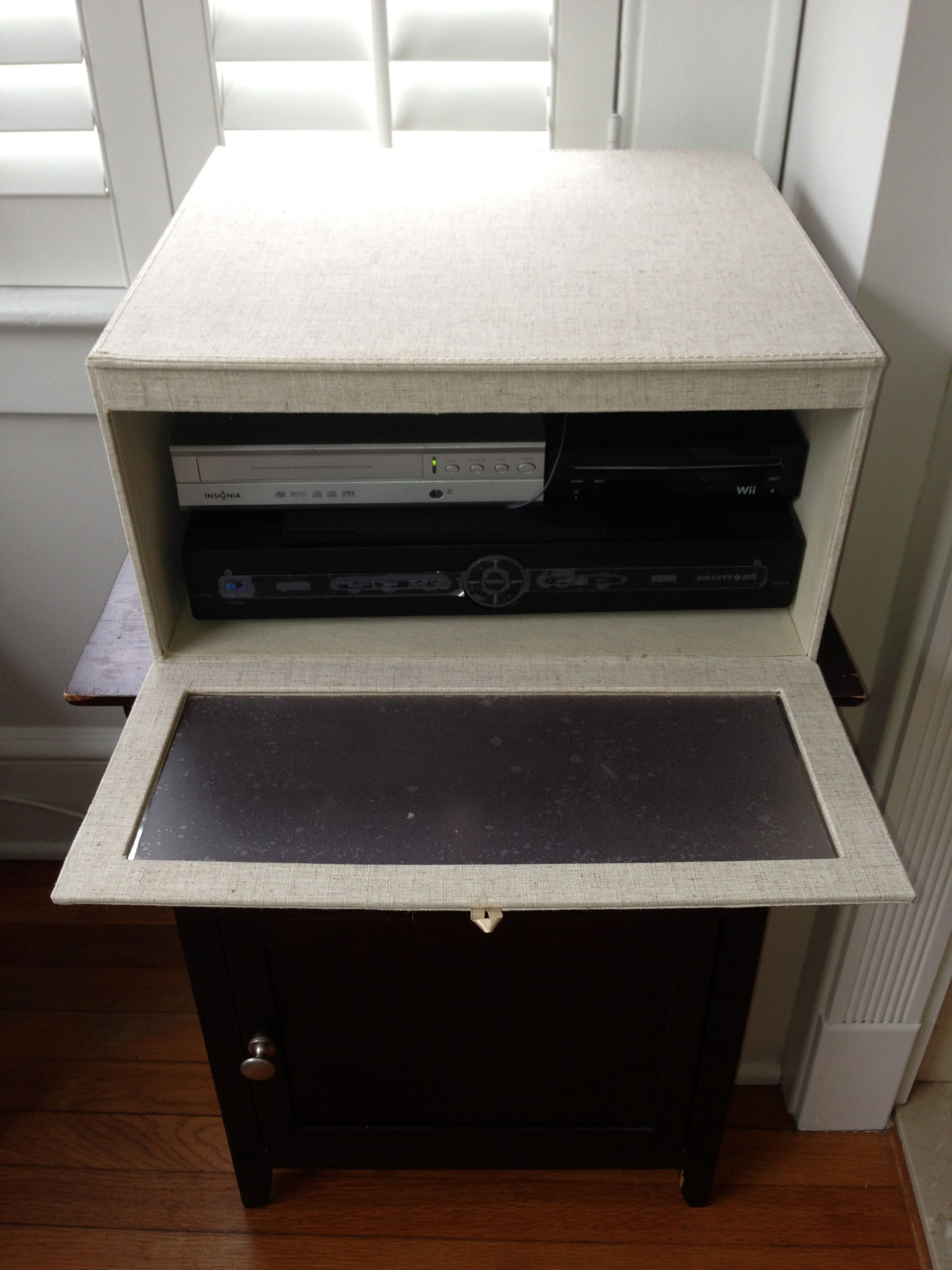 Linen sweater box from Container Store hides cable box dvd player