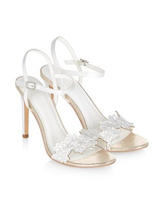 d1fbf7dd643 Our shimmery Ayda bridal heeled sandals are embroidered with flowers ...