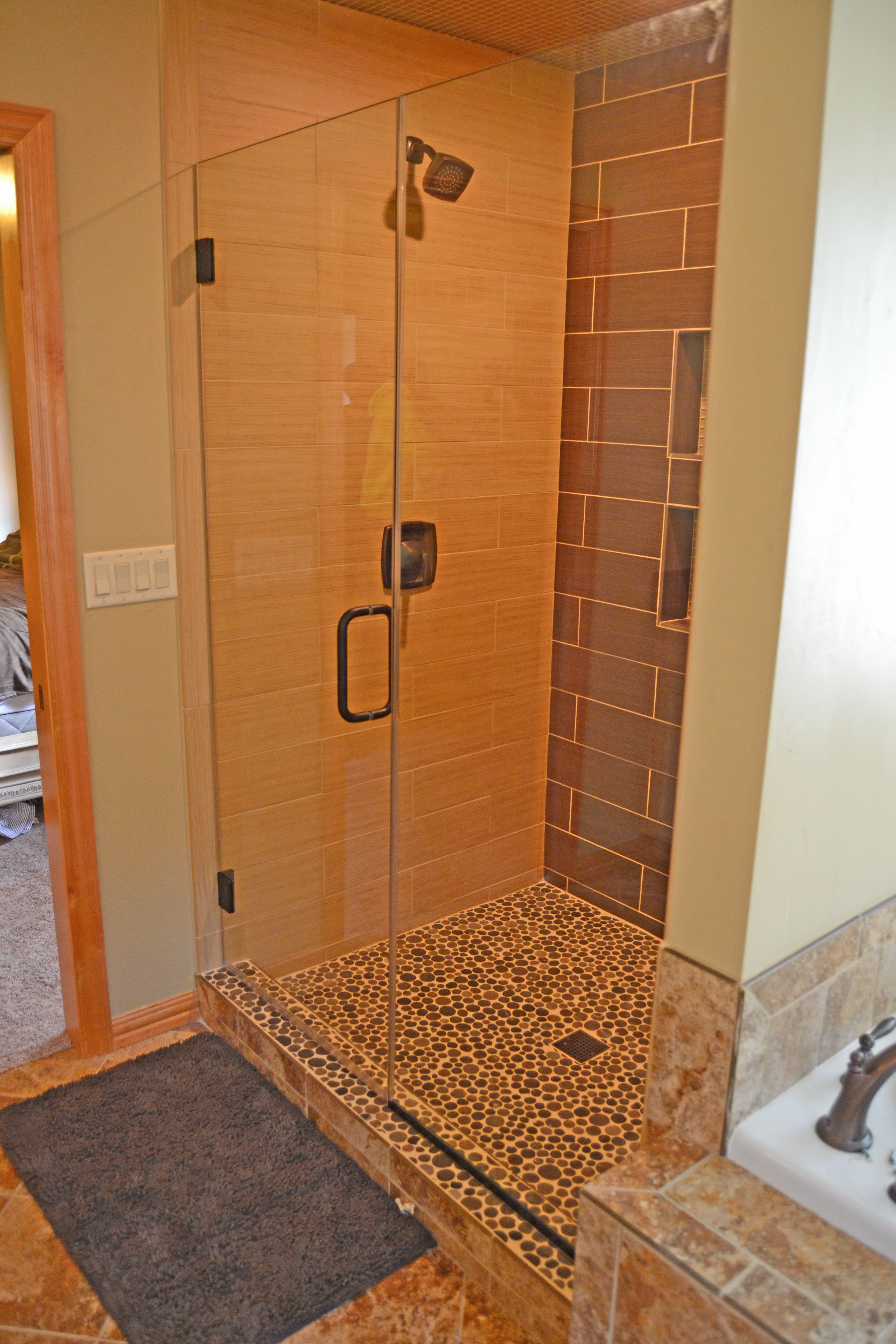 Heavy Glass Shower Door And Panel With Oil Rubbed Bronze Hardware