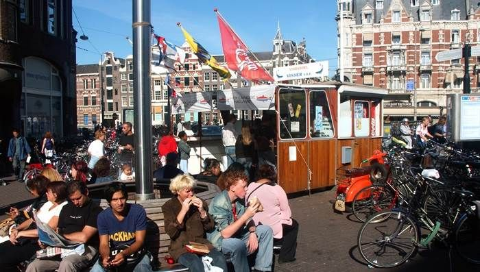 Try herring from a herring cart http://www.iamsterdam.com/en/visiting/what-to-do/top-20-things-to-do-in-amsterdam