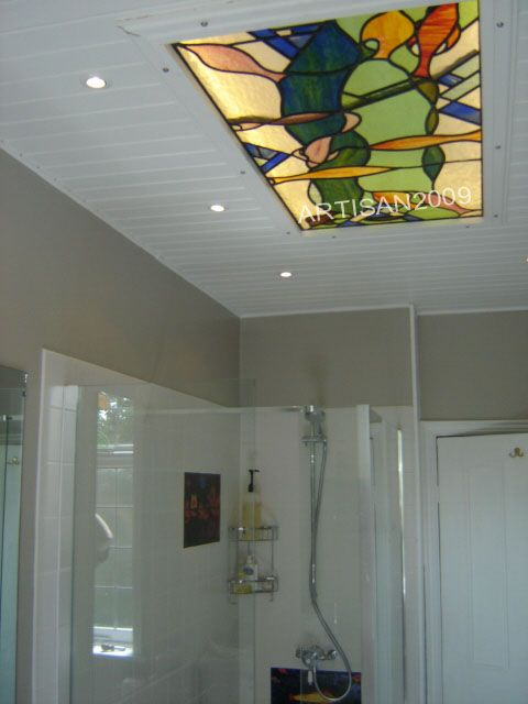 kitchen ceiling stainglass lights above a modern stained glass