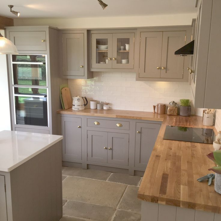 Photo of Gray, country cottage kitchen with island and wooden worktops – decor