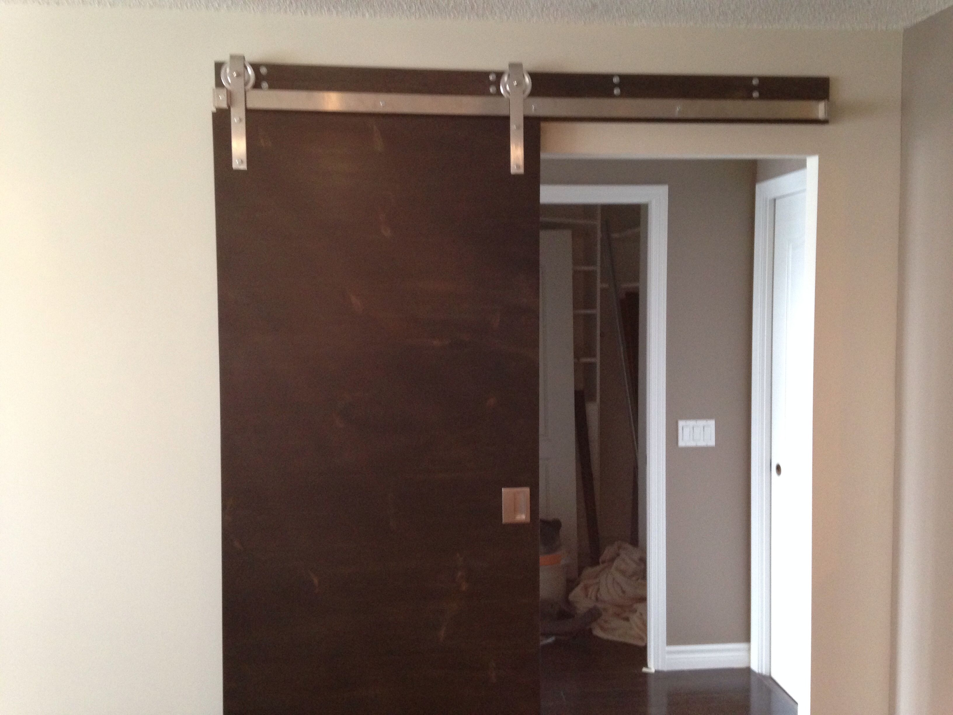 Pine Slab Door Stained Ebony On Stainless Steel Barn Door