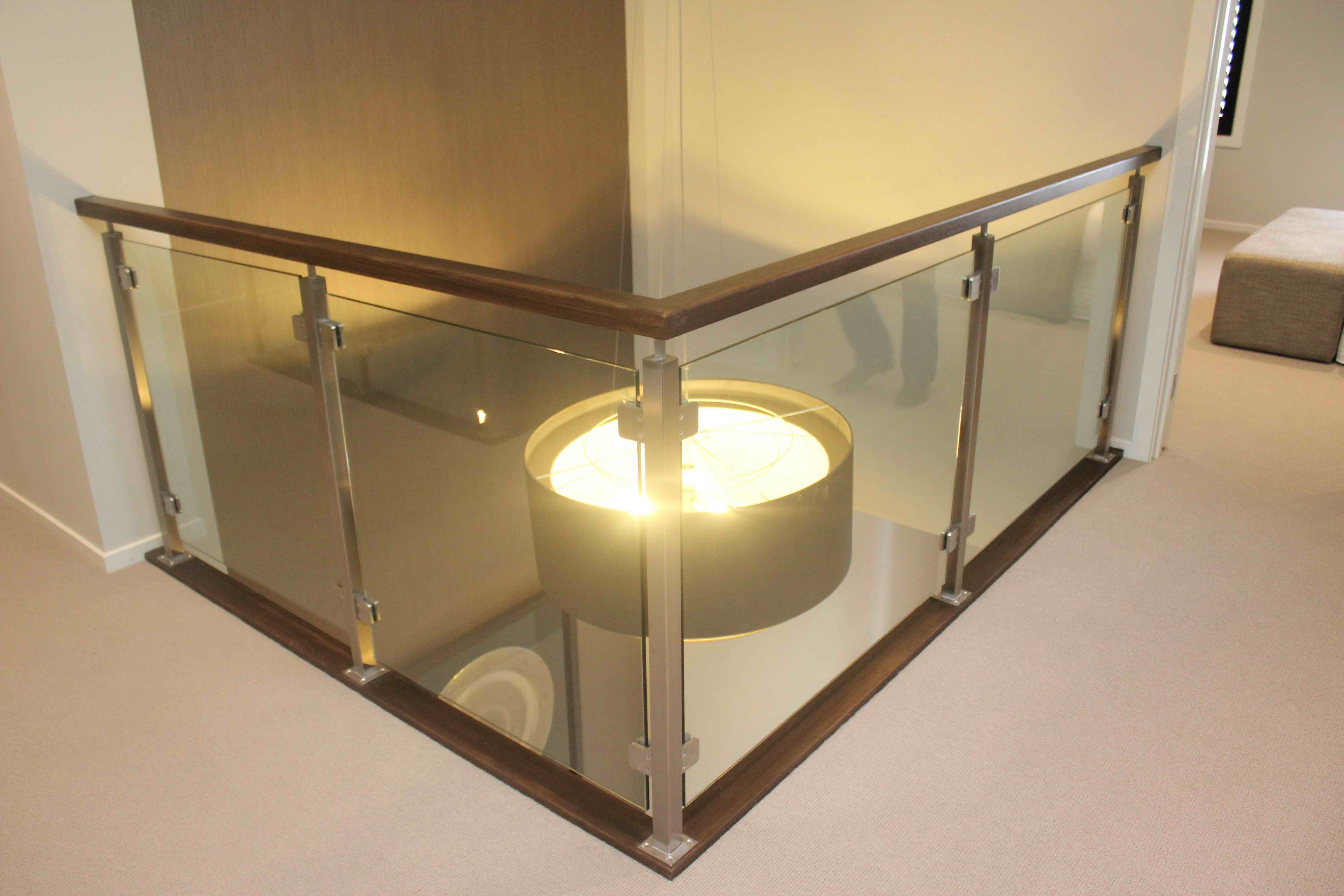 Timber Handrail And Glass Balustrade Stair