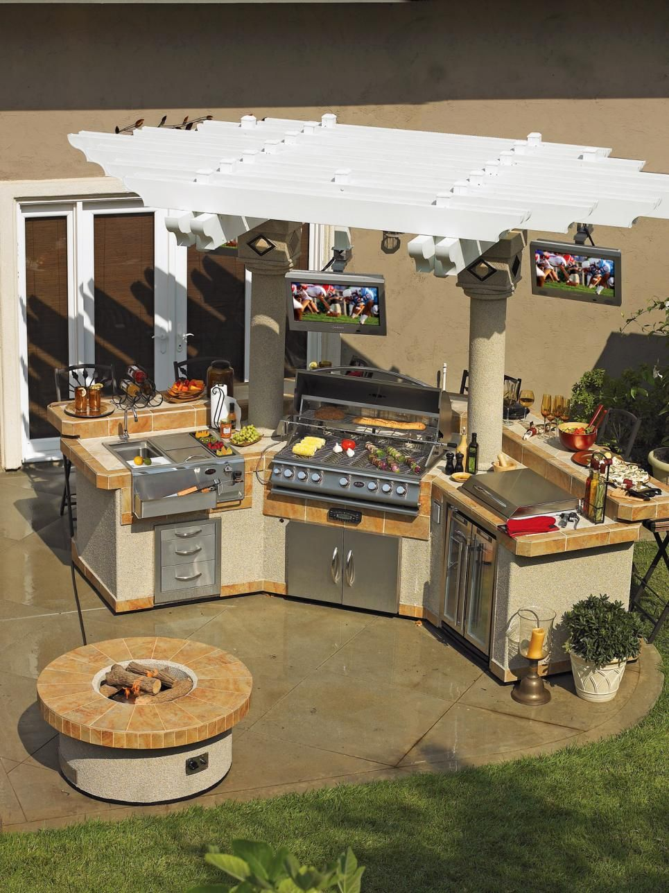 outdoor kitchens that sizzle white pergola hgtv and flatscreen