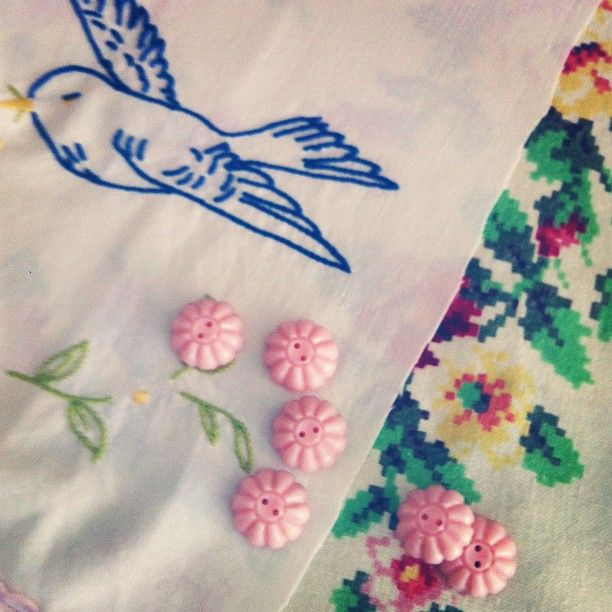 making vintage cushions with vintage tablecloths and buttons
