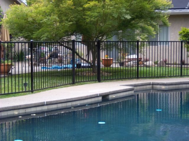 Steel Fencing Is The Best Way To Keep The Kids Out Of A Pool And Still