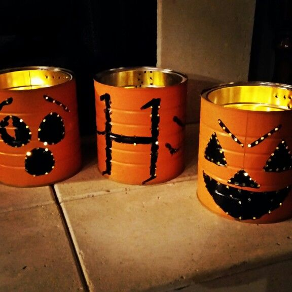 Coffee can lighted pumpkins Paint and drill holes...place candles inside