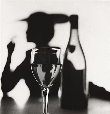 Irving Penn: Girl Behind Glass (model Jean Patchett). New York, 1949.
