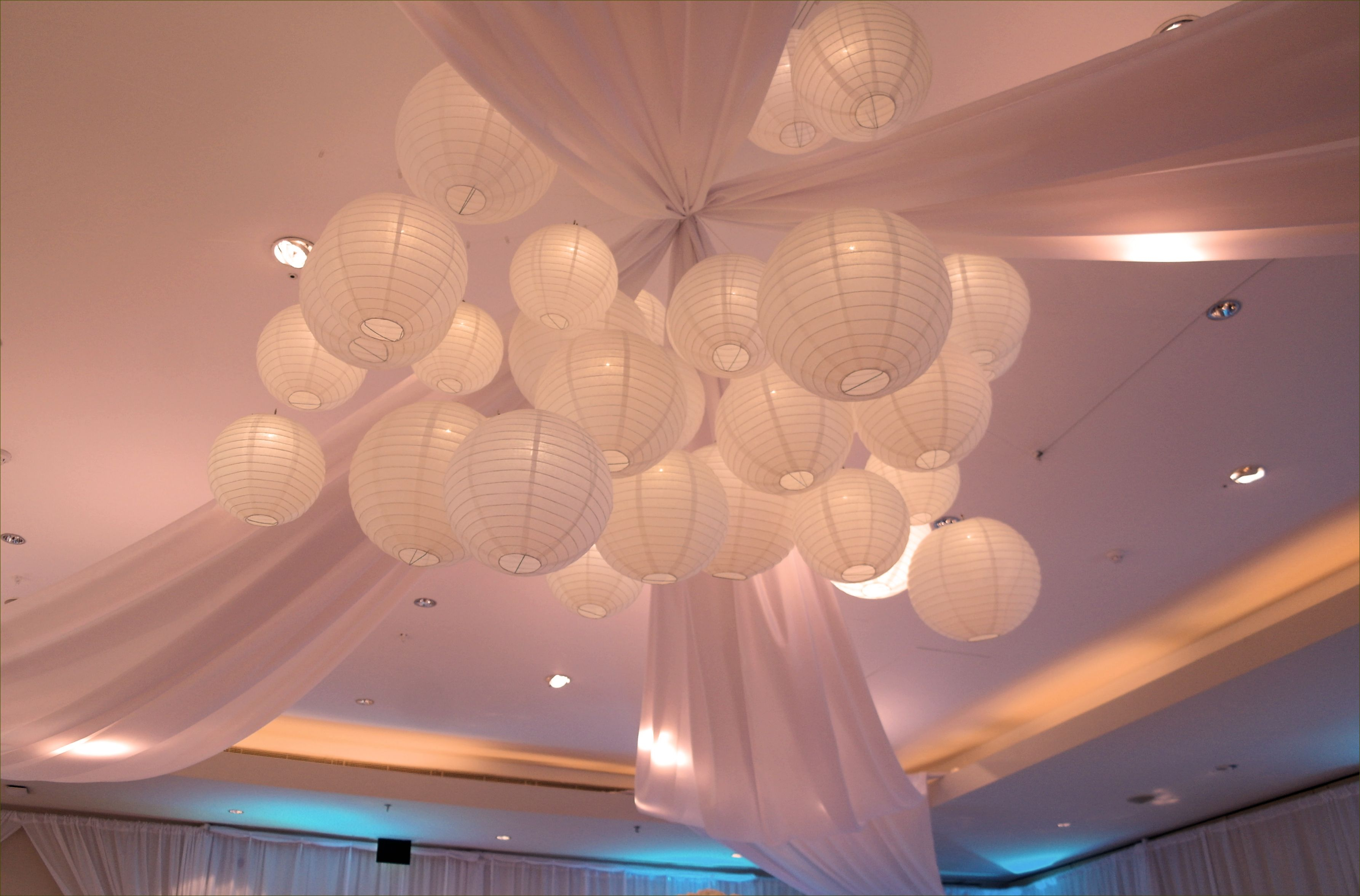 Hanging paper lantern cluster forming a lantern chandelier with four hanging paper lantern cluster forming a lantern chandelier with four leg fabric swags at the hurlingham arubaitofo Choice Image