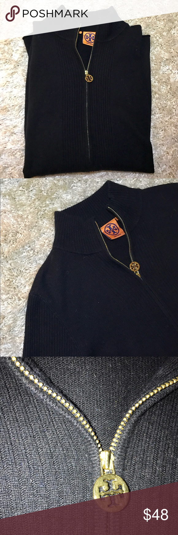Tory Burch 3/4 zip sweater Tory Burch 3/4 front zipper black sweater. Wool/cashmere blend. Signature gold emblem on zipper. Great condition! Will clean before shipping! Offers welcome 💕 Tory Burch Sweaters