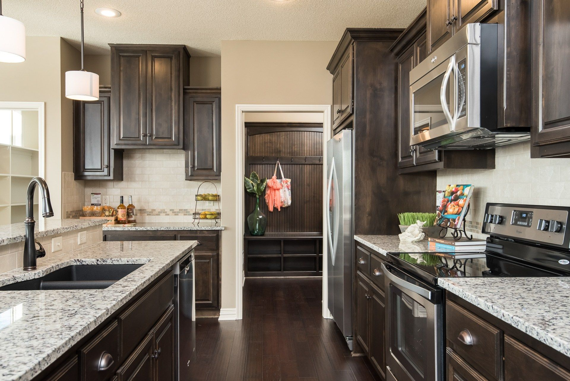 An Elegant Kitchen Opens To A Drop Zone With Custom Storage. The Palmer  Plan, · Summit HomesBlue SpringsDrop ...