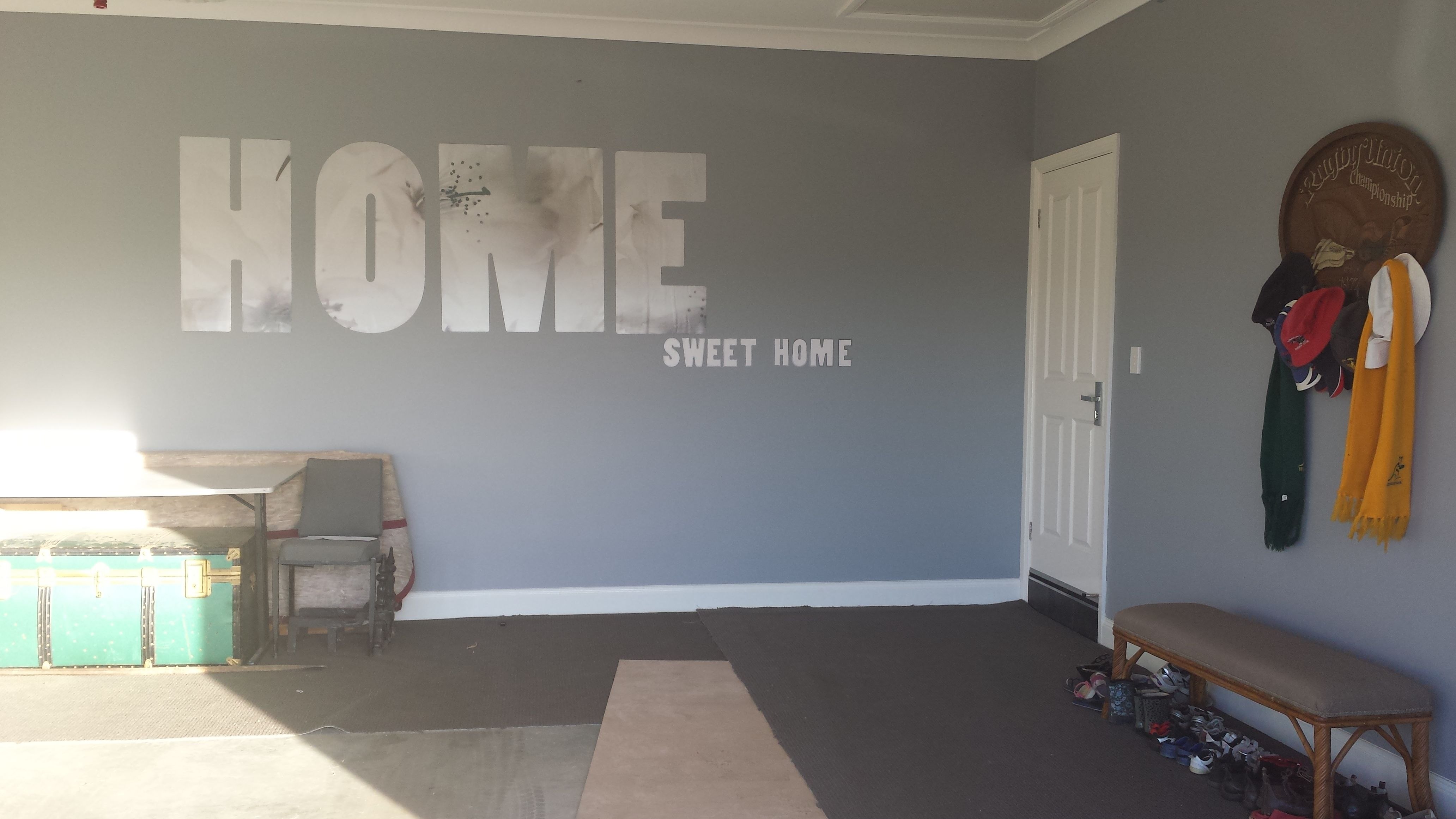 Garage space a great thoroughfare home sweet home sign carpet near