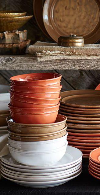 Orange dining room & Rustic Stone Dinnerware...love all of the colors. #LGLimitlessDesign ...