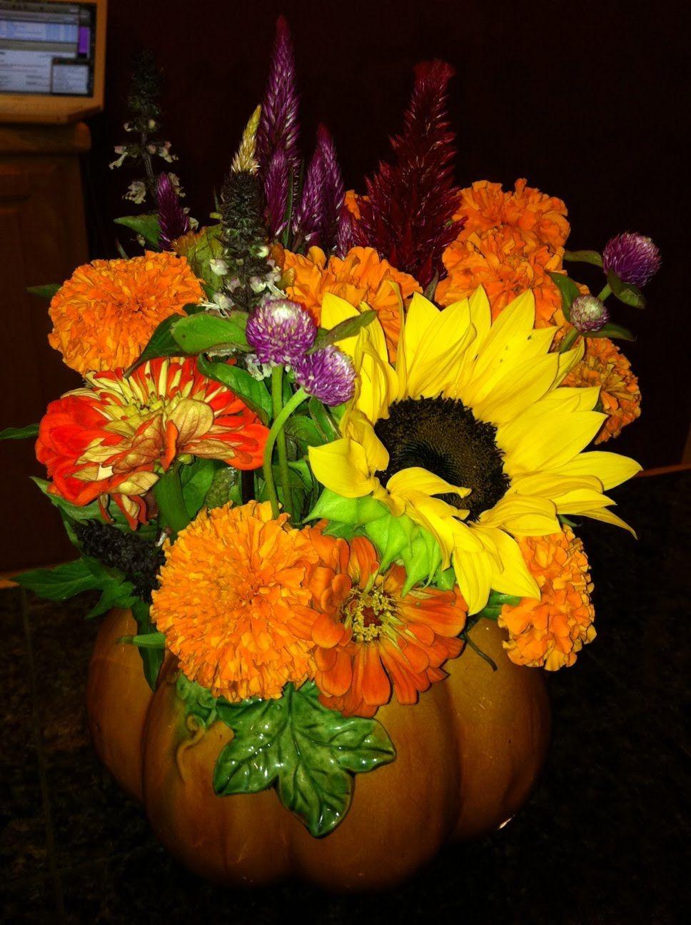 beautiful flowers in a pumpkin for fall wedding