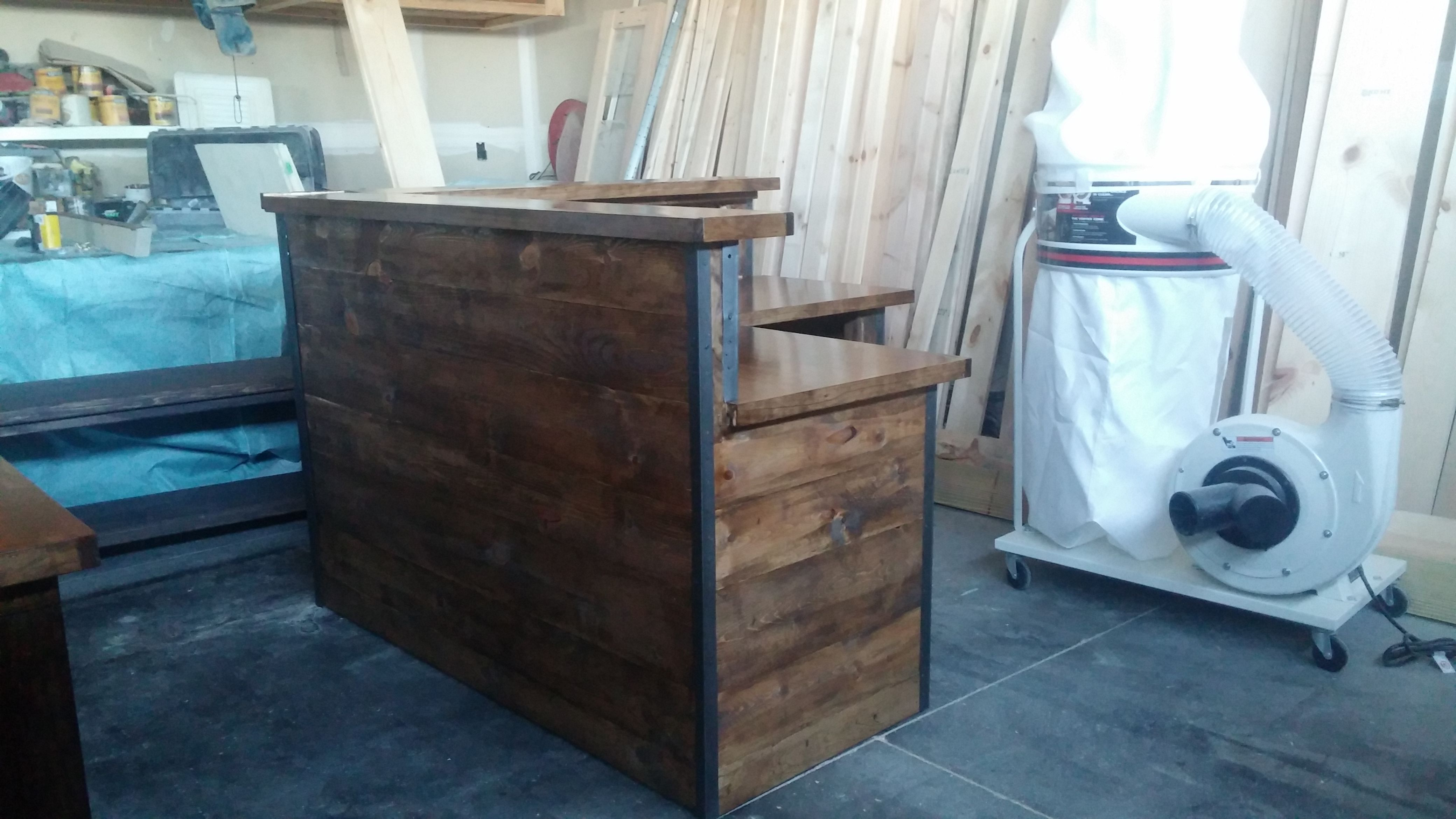 L Shaped Reception Desk Done In Rustic Facing With A Metal Edge Reception Desk Handcrafted Dining Table Desk