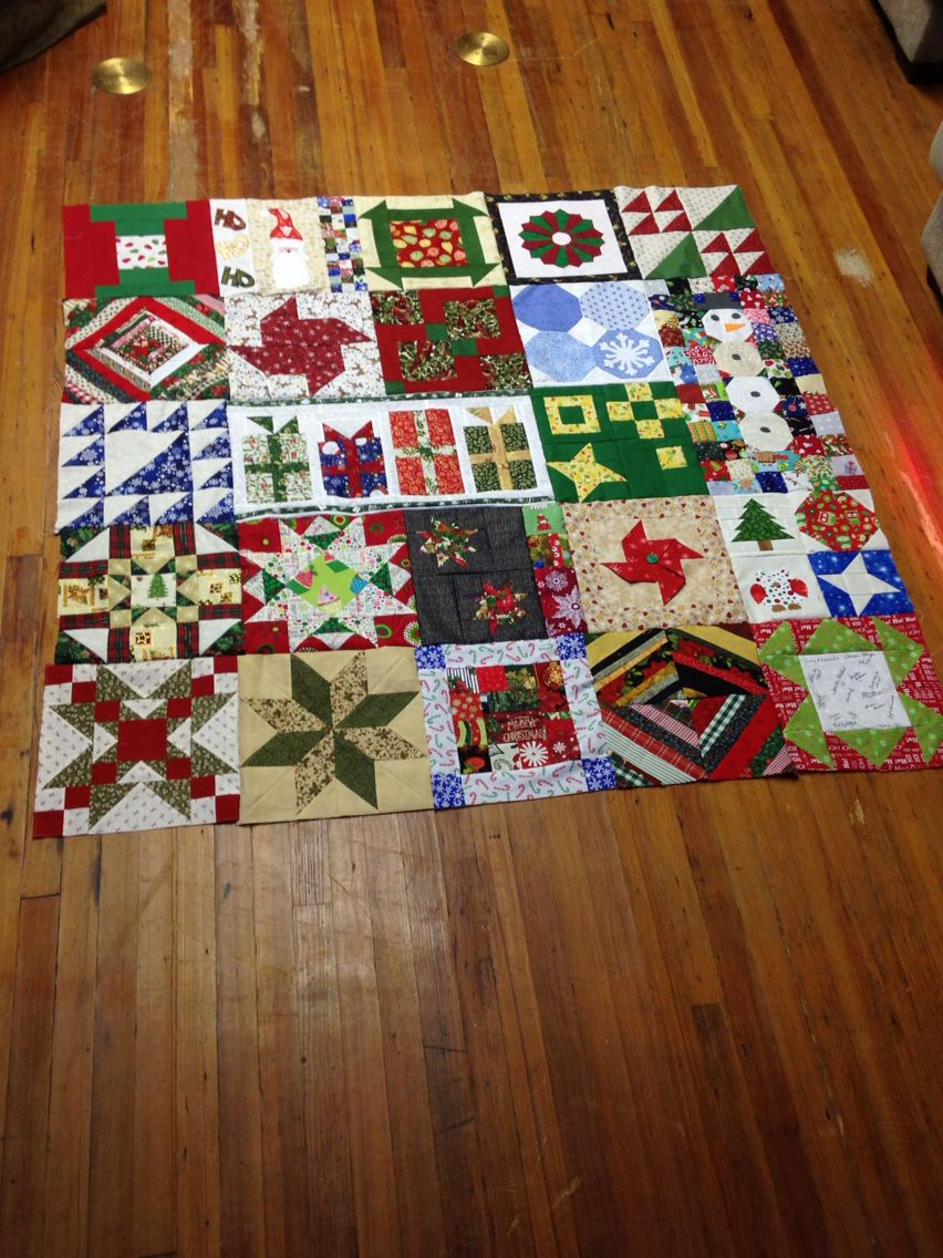 "Christmas quilt - 12"" block swap. Additional 5 blocks added, needs one more row and borders"