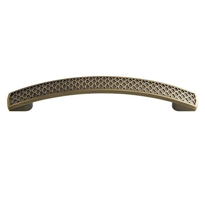 This antique brass finish oversized cabinet pull with scalloped ...