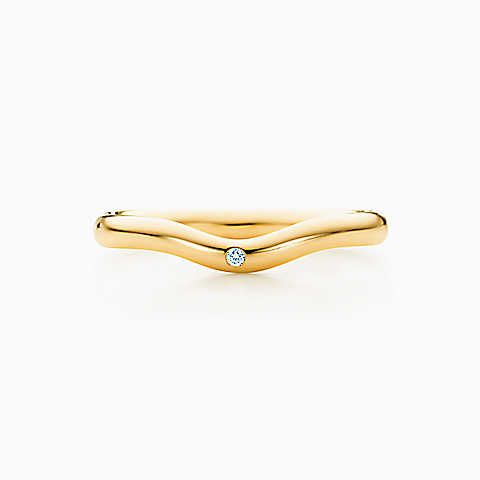 Elsa Peretti wedding band ring with a diamond in 18k gold 2 mm
