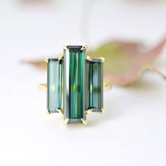 Photo of WILLOW 13.25 Ct. Baguette Cut 3 Stone Blue Green Tourmaline Ring with Diamond Accents on 18K Yellow Gold