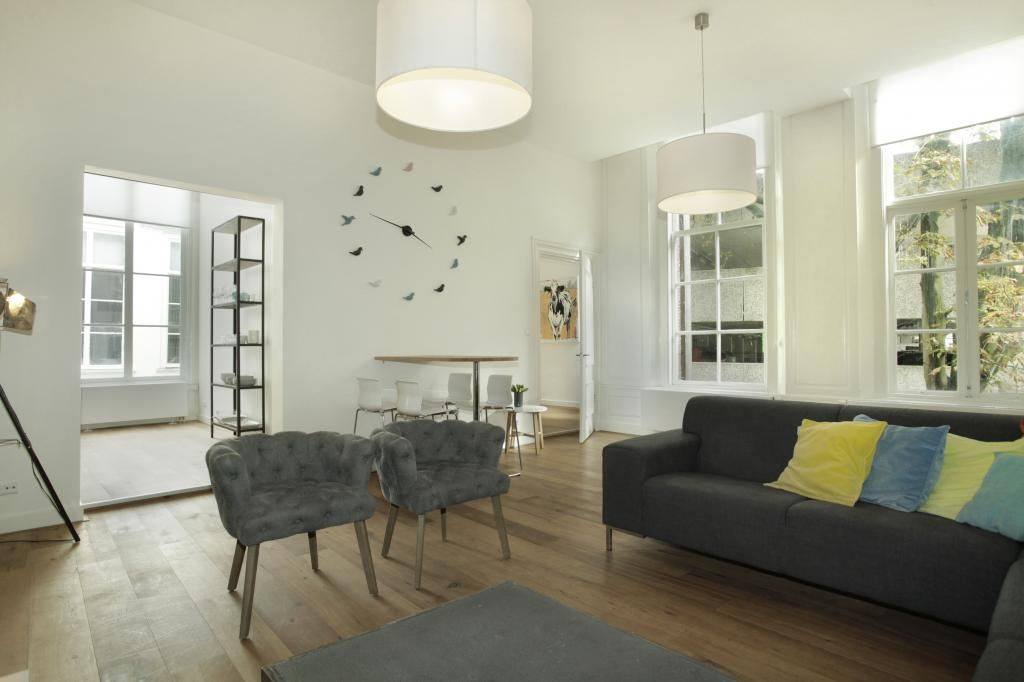 Living room of this spacious, modern apartment makes a great base in The Hague, close to everything in the heart of the city.