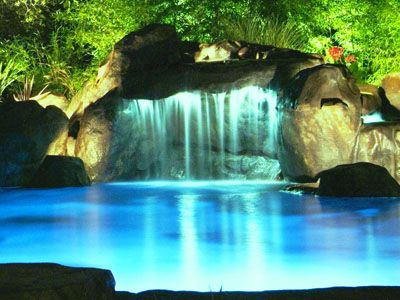 grotto behind waterfall another great design by natural design pools