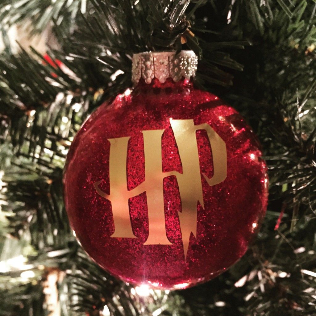 Harry Potter Ornament Made With A Diy Glitter Ornament And Cricut Vi Harry Potter Christmas Ornaments Harry Potter Christmas Decorations Harry Potter Christmas