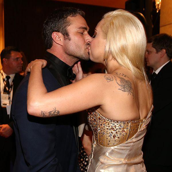PHOTO: #LadyGaga and #TaylorKinney kiss at #GoldenGlobes bash