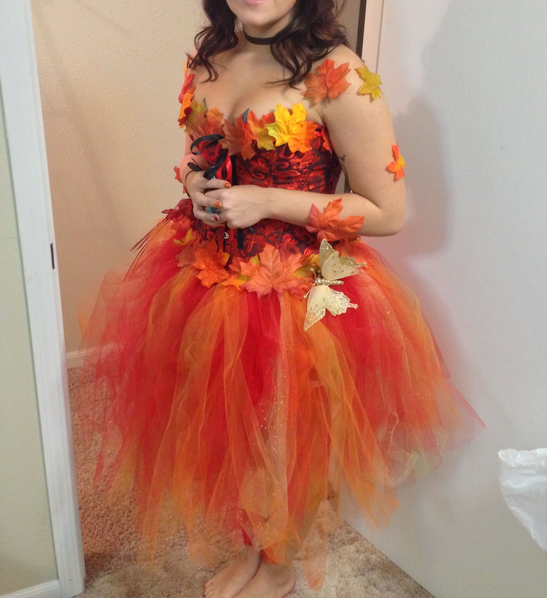 Mother Nature #Costume for Halloween. Supplies Needed 1. Colored tool (I used 1 spool red/1 spool orange, & partial spool gold glitter) 2. Chocolate Brown ribbon 1/2 - 1 in 3. Double side fabric tape 4. Fall craft leaves (garland or bag) 5. Scissors 6. Corset (mine via Amazon-$10) 7. Optional - animals, butterflies, etc. Google how to make a non sew tutu, super easy! Use tape to put leaves on trim of costume & all over arms & legs & body. Message if u need/want more help! #fabrictape