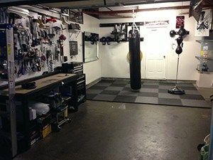 Boxing themed home gym in the garage perfect for mma types and