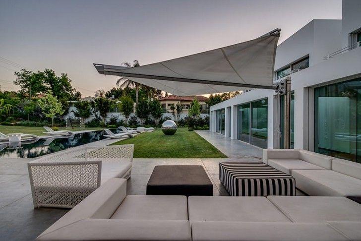 Home design patio umbrella in brown grey porcelain floor white sofa wooden sofa black and
