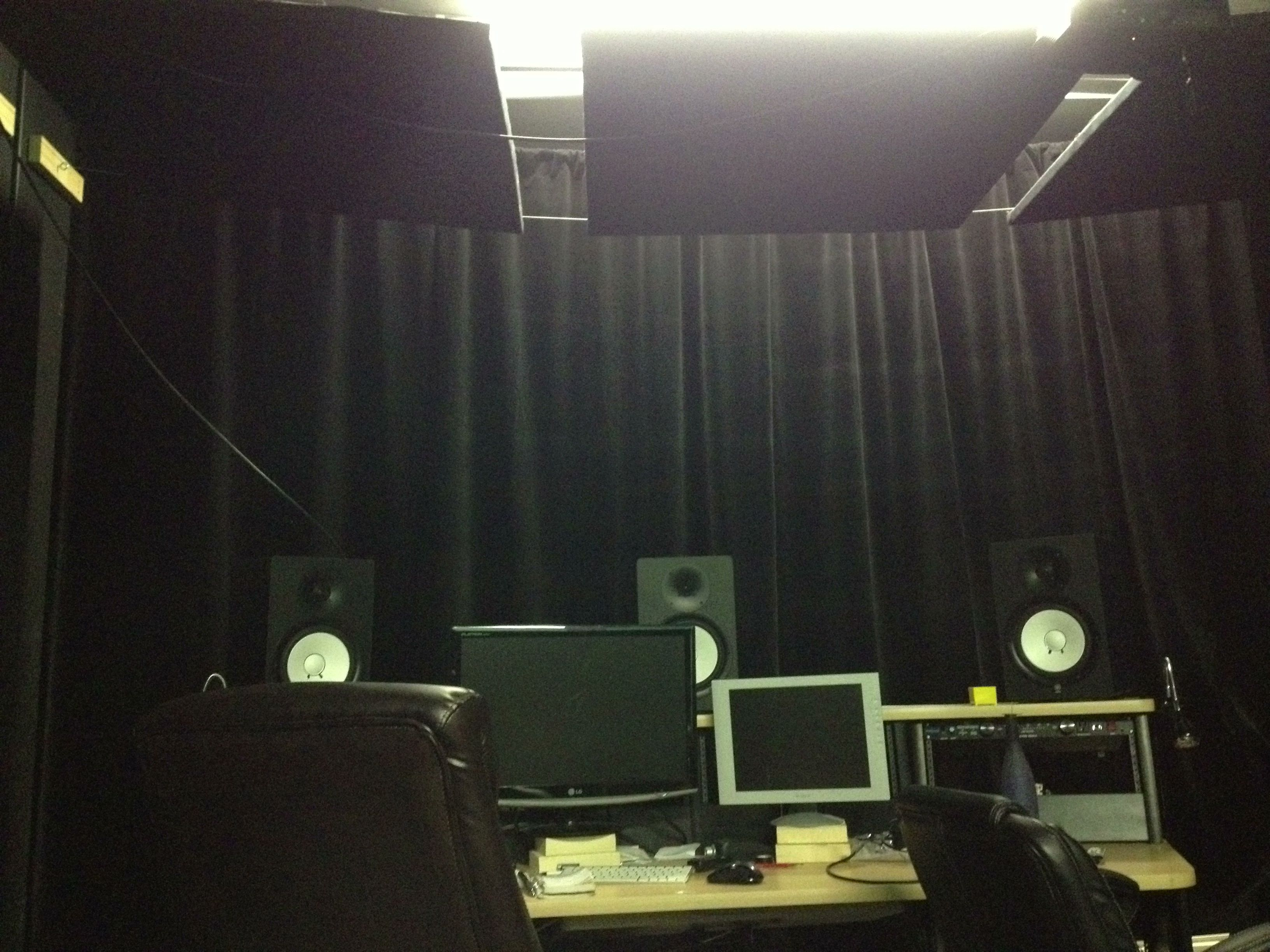 Recording Studio Surround with Velvet Curtains for Ultimate Sound Absorption.