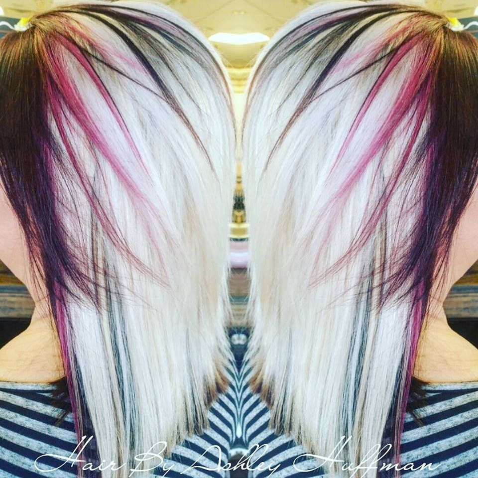 Platinum hair with red violet face framing travel world