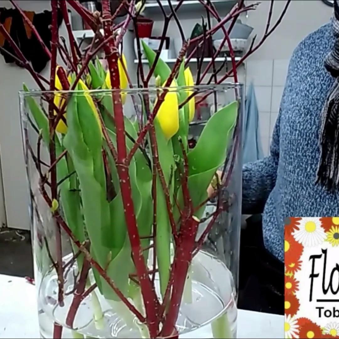 Photo of Tulips in vase table decoration idea