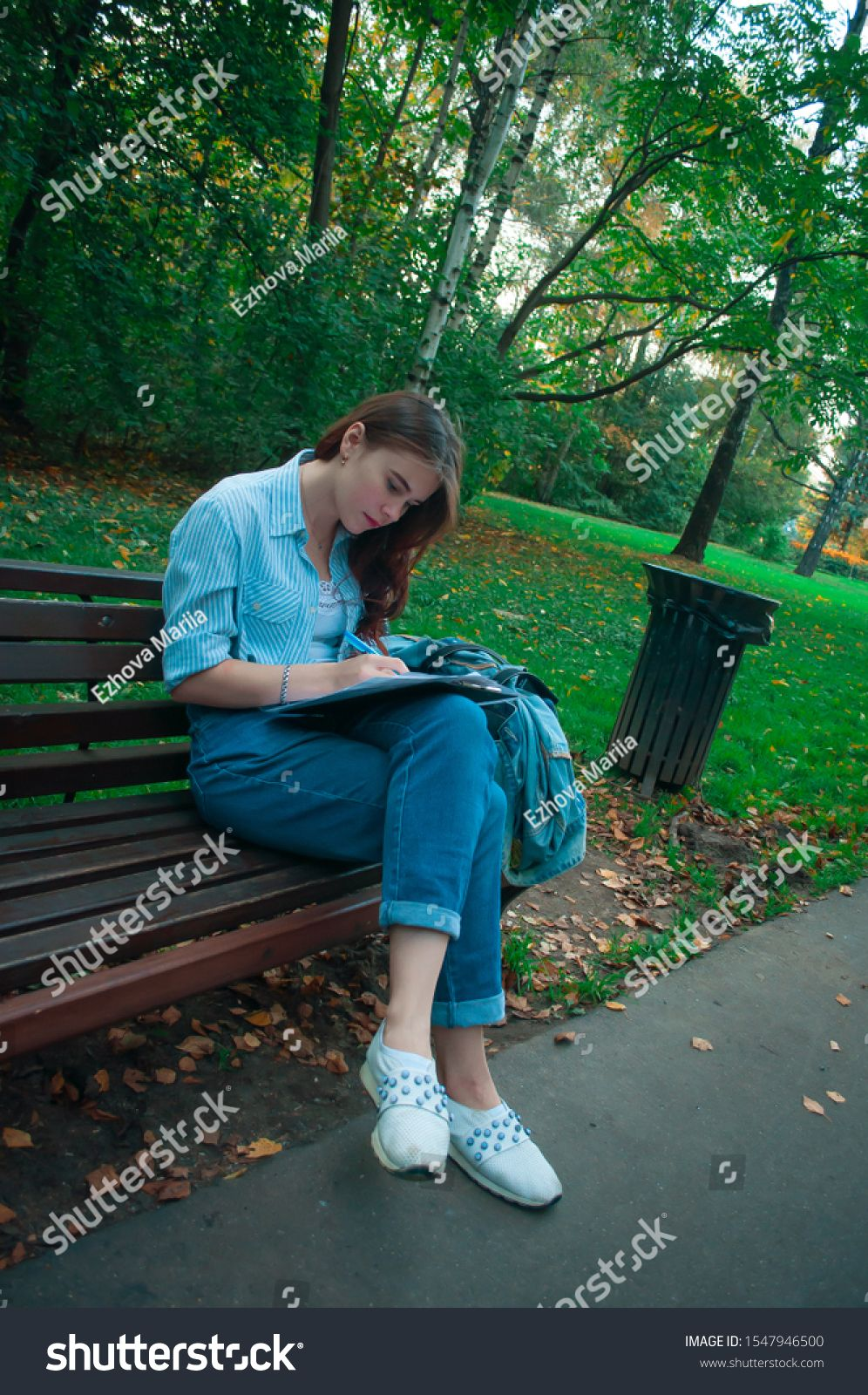 Young Beautiful Happy Girl Sitting In The Park On A Bench Smiling And Making Notes The Concept Of Working Outdoors Freelance Sponsored Aff Sitting Park