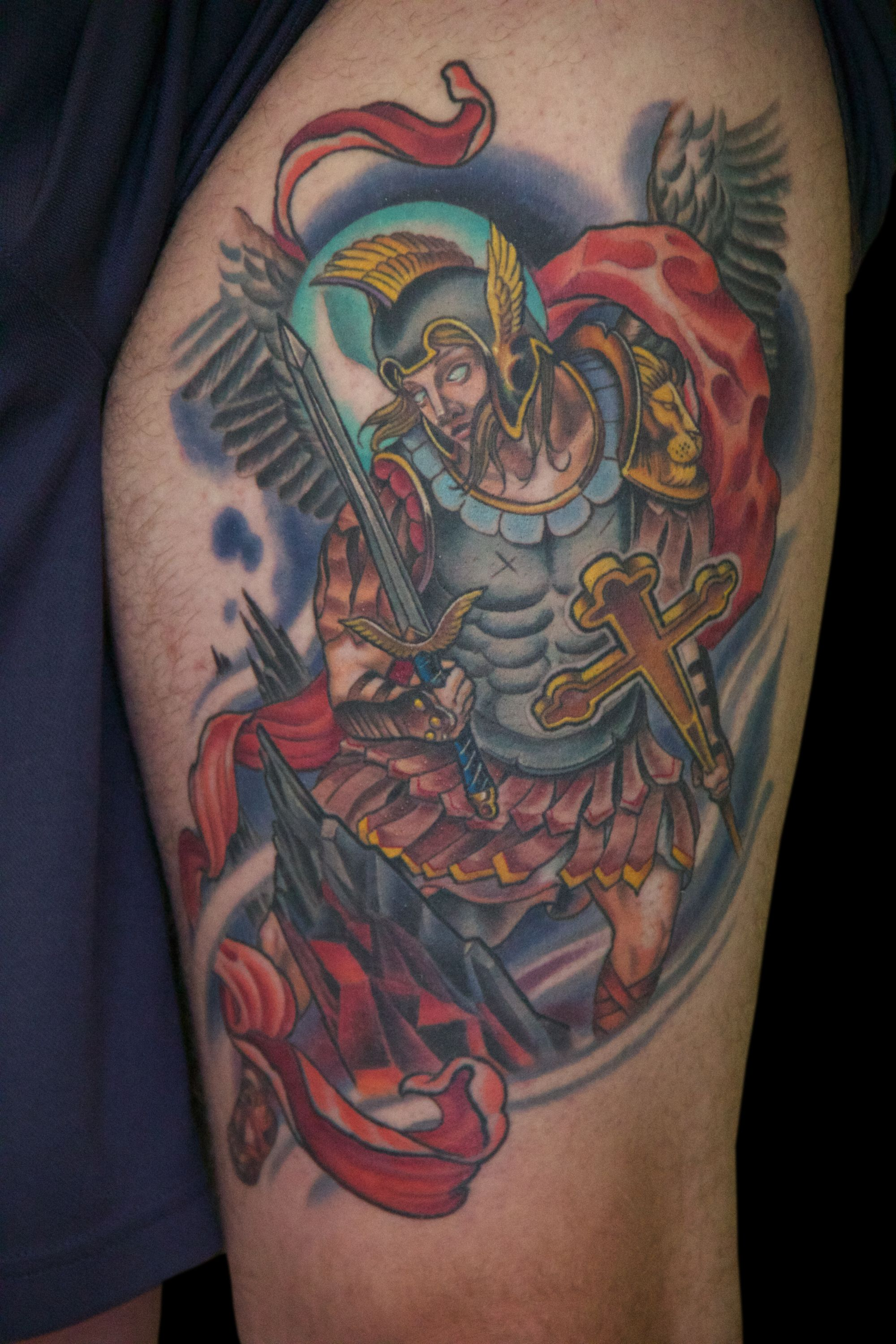 I do a lot of saints and religious icons, but they are often in realistically rendered black & grey. This was a fun and more illustrative version of St. Michael in color- nice to change it up sometimes! #ryanthompsontattoos #tradewindstattoo #njtattooartist #tomsrivernj #tattoo #guyswithtattoos #cooltattoos #thightattoo #legtattoo #stmichael #stmichaeltattoo #religioustattoo #inkedguys #colortattoo #illustrativetattoo #radtattoos #tattooedguy #eternalink #tattooartist #tattoostyle #healedtattoo