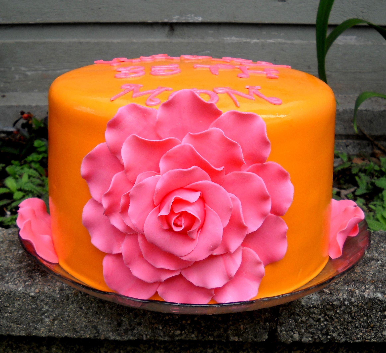 Giant Rose Cake In Orange & Pink Decorating