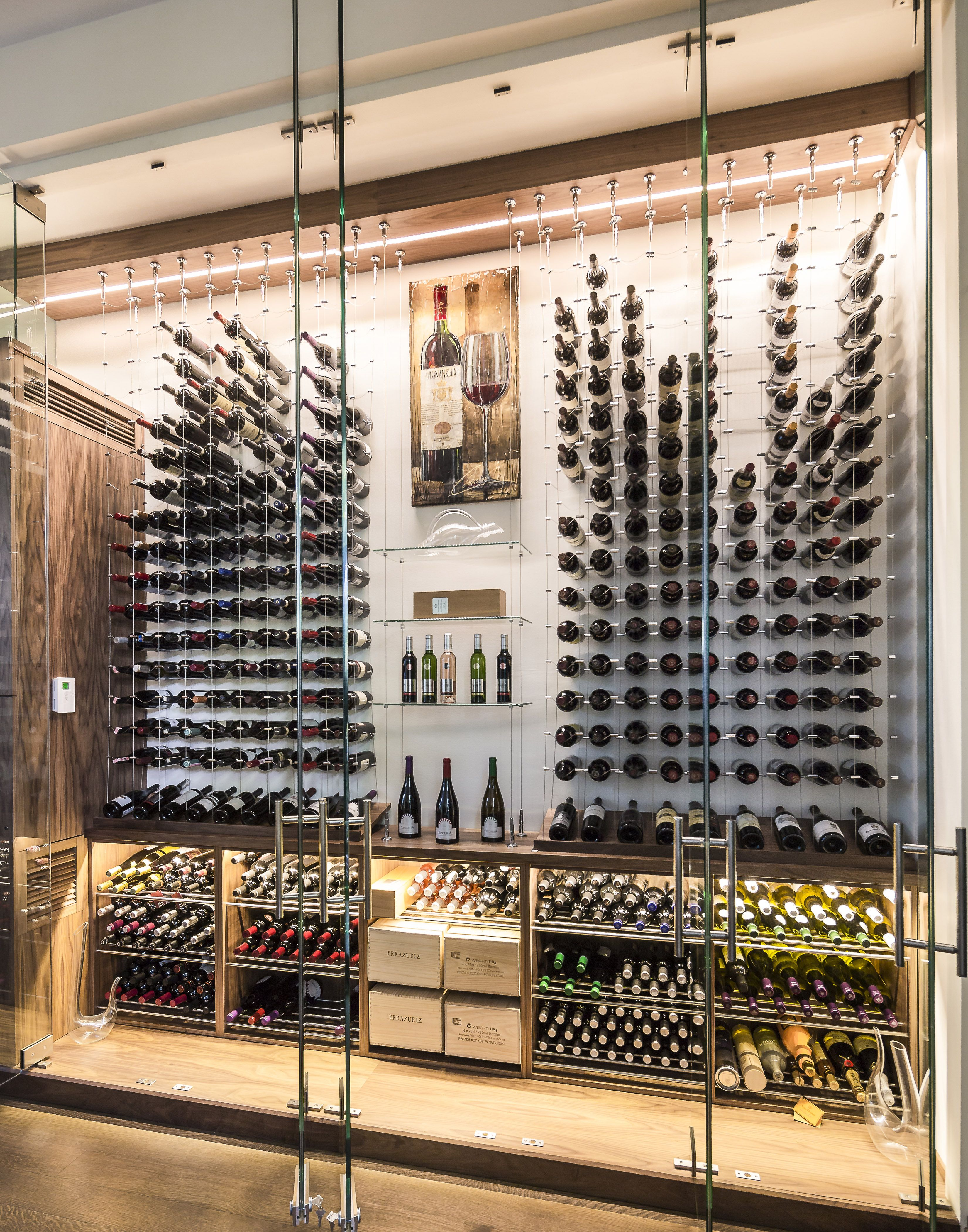 Modern custom reach in wine cellar featuring the cable for Custom wine bar