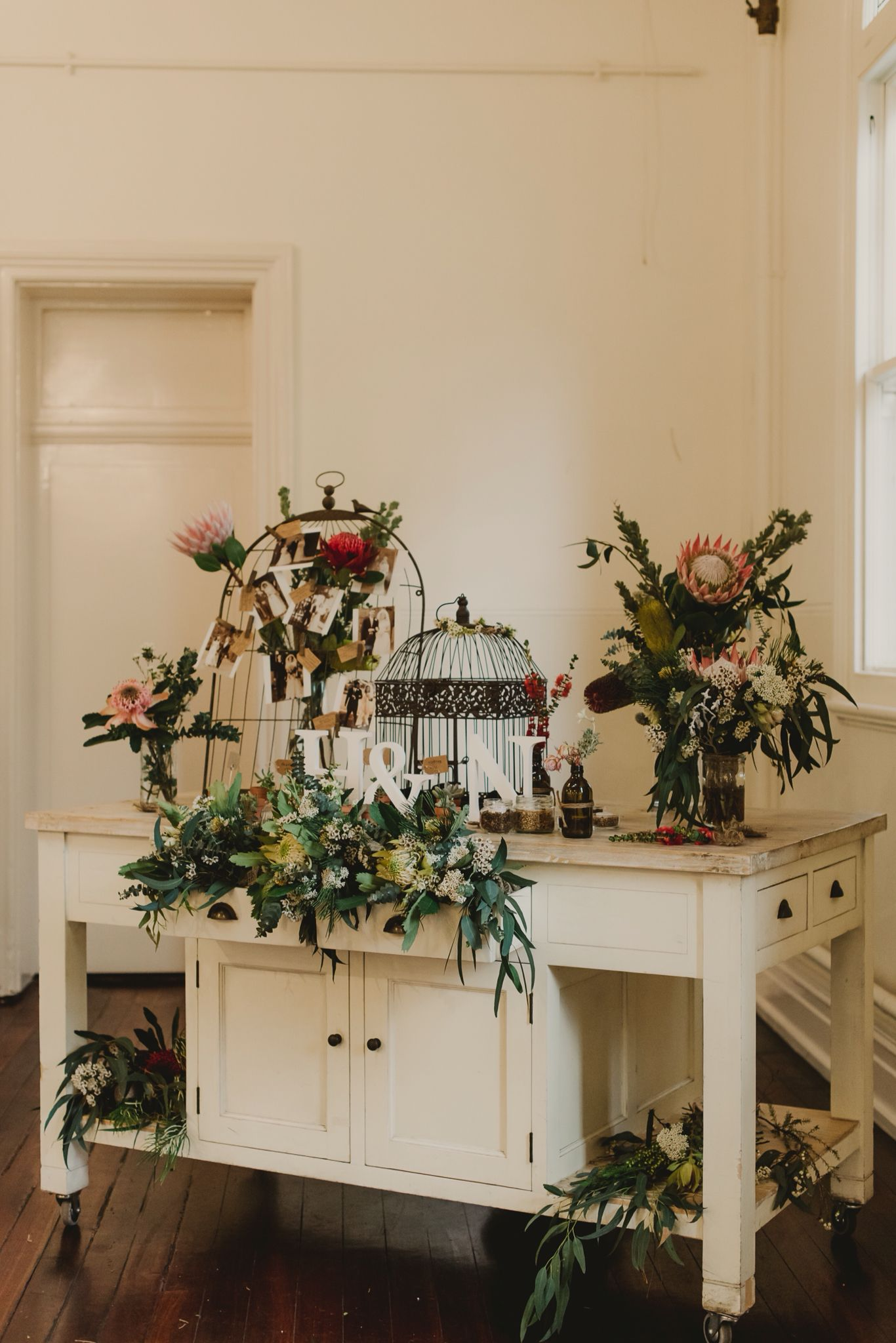 Reception venue, gift table, wishing well, bird cage