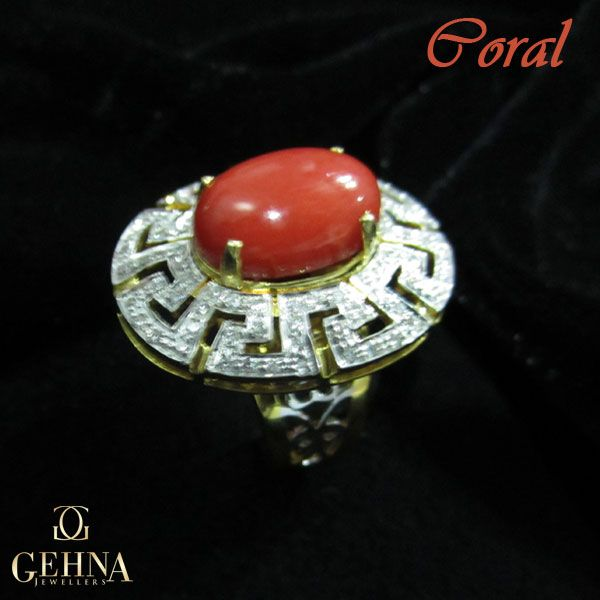 This #ring #studded with a #coral stone & #diamonds will definitely #glam up your #traditional attire for the day!