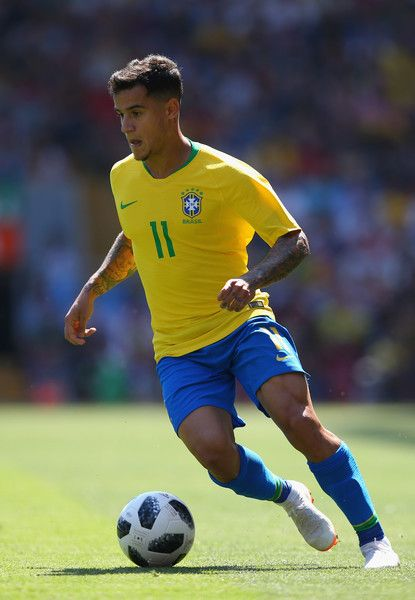 Philippe Coutinho Photos - Philippe Coutinho of Brazil runs the ball during the International friendly match between of Croatia and Brazil at Anfield on June 3, 2018 in Liverpool, England. - Philippe Coutinho Photos - 7 of 1667