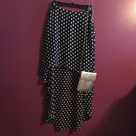Forever 21 High-Low Navy Polka Dot Skirt This cute polka dot high-low skirt is perfect for any occasion! It has a zipper closure on the side and can easily be dressed up or down! Forever 21 Skirts High Low