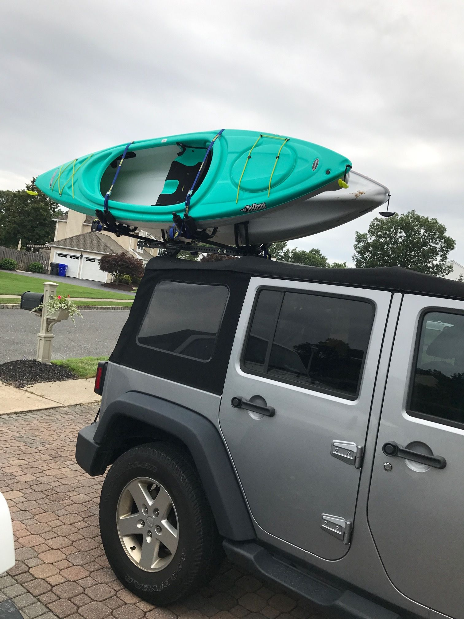 Jeep Wrangler With The Hitchmount Rack System Holding Two Kayaks