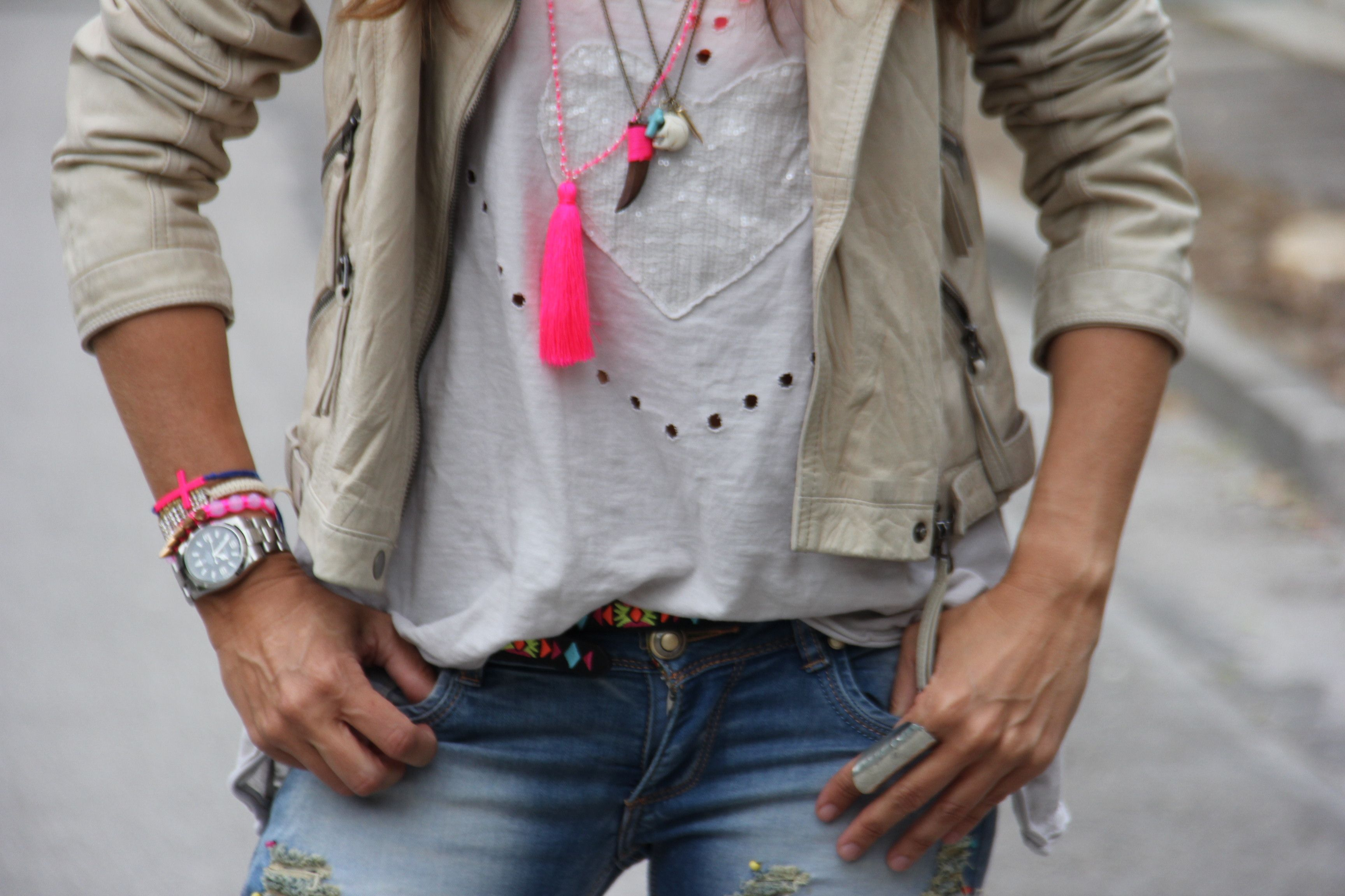 ethnic jeans and leather jacket and neon necklaces