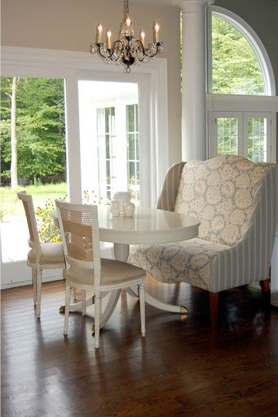 Dining Rooms   Wing Chair Breakfast Room Wingback Settee, White Pedestal  Table And Crystal Chandelier.